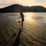 soccer juggling beach